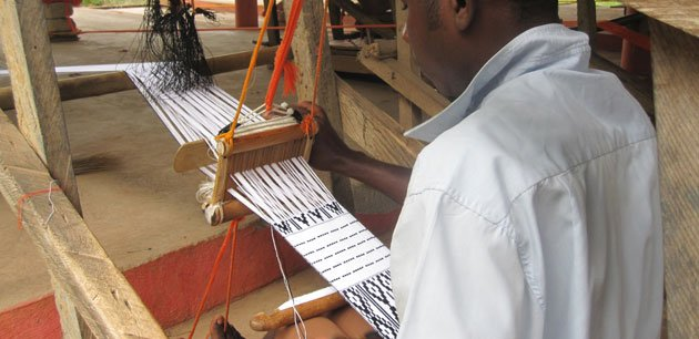 A man working on a loom
