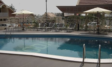 Outdoor pool area of Noda Hotel
